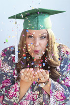 A graduate with confetti