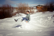 a man tubbing in the snow
