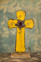 yellow wooden cross
