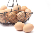 fresh eggs in a wire basket