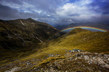 rainbow over a mountain valley