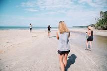 friends walking on a beach