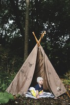 an infant boy in a teepee