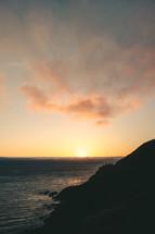 mountainous shoreline at dusk