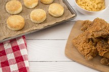Classic Southern Fried Chicken and biscuits on a White Wood Table