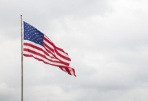 American Flag with a Blue Cloudy Sky