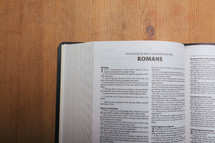 Romans on the pages of an open Bible