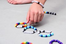 child making beaded bracelets at VBS