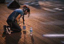 a woman kneeling down on stage