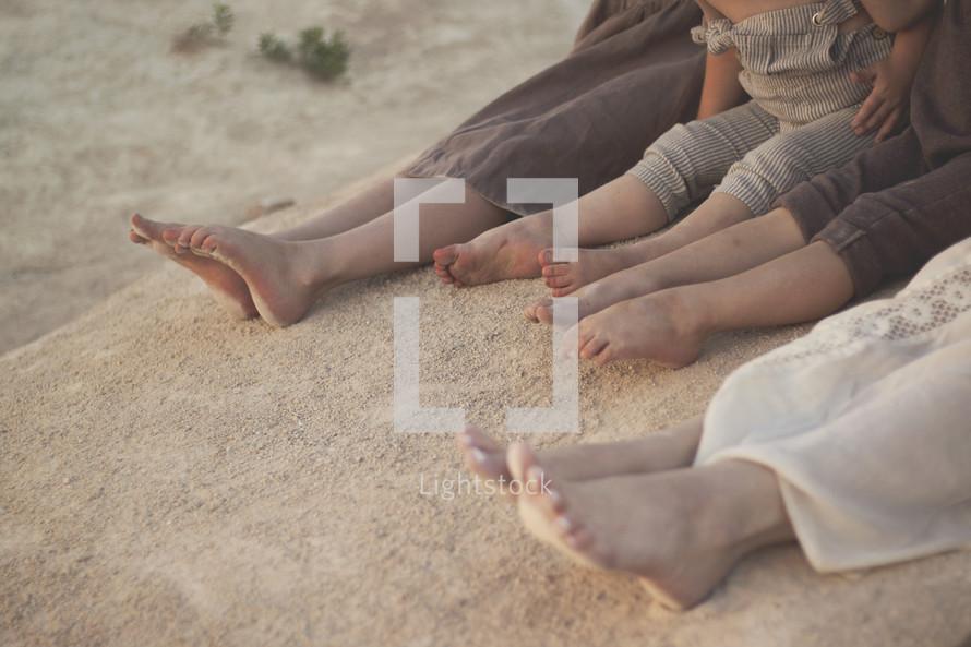 kids bare feet in beach sand