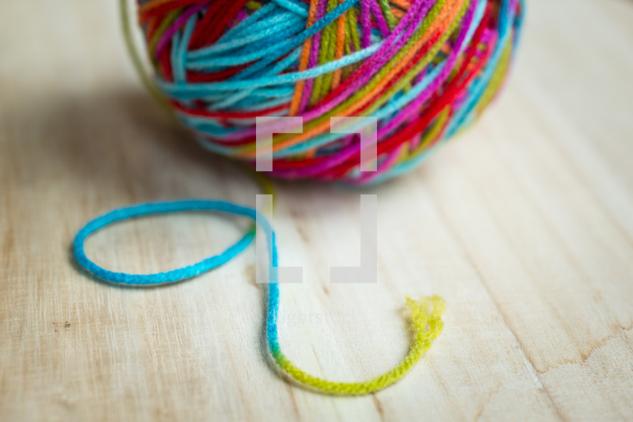 ball of rainbow colored yarn