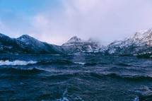 snow on mountain peaks and ocean water