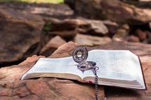 compass on an open Bible