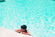 little boy at the edge of a pool
