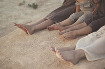 kids bare feet in beach sand