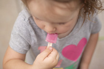 toddler eating a popsicle