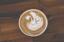 swan design in creamer in coffee