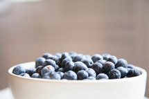 Close up of fresh blueberries in a bowl.