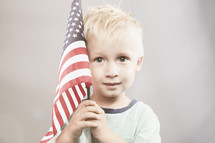 boy child holding an American flag