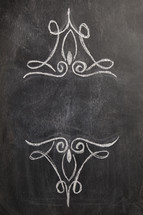 decorative scrolls on a chalkboard