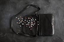 purse with spilled pills