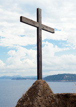 Wooden cross in the Aragonese Castle sheer above the sea