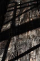 shadow on wood boards
