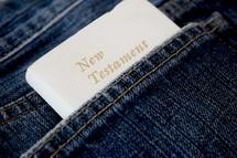 pocket New Testament Bible in a jeans pocket