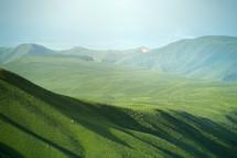 sunlight on a green mountaintop