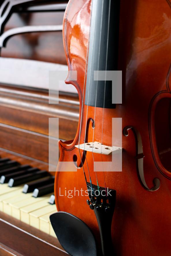 violin on a piano