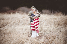 military couple wrapped in an American flag