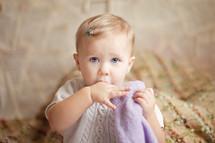 toddler girl sucking her thumb