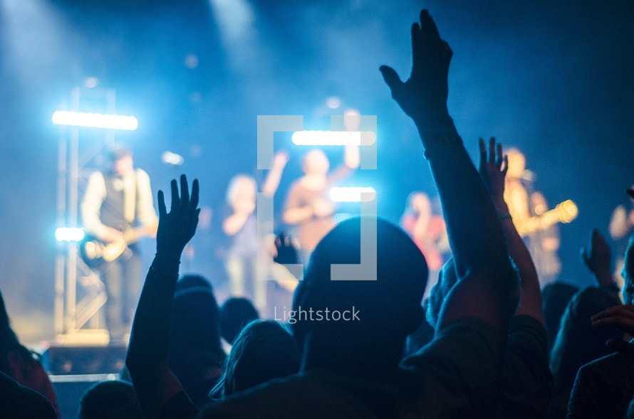 Hands raised at a concert