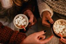 women drinking hot cocoa