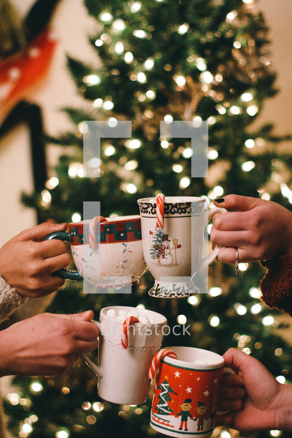 toasting with mugs of hot cocoa
