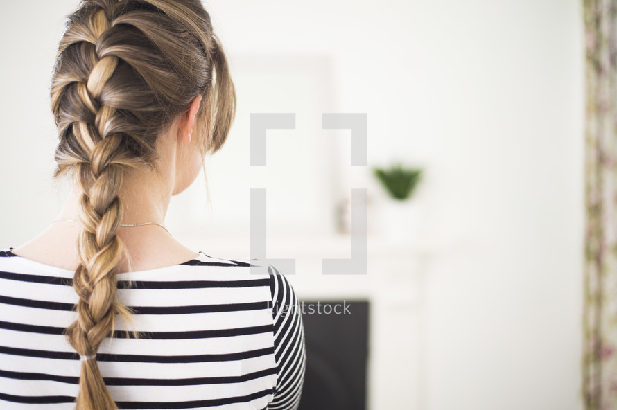 a woman with braided hair
