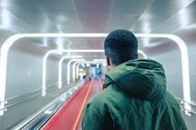 a man walking through an airport terminal