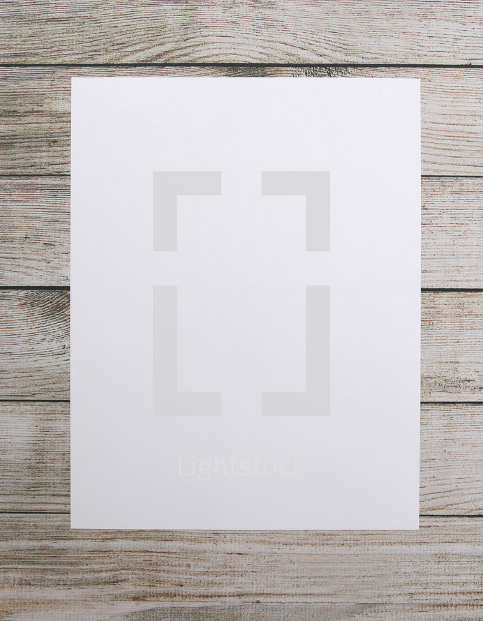 blank white paper on wood boards
