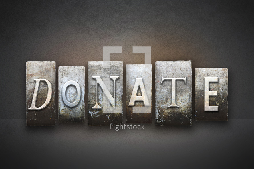 Stone tiles spelling the word DONATE.