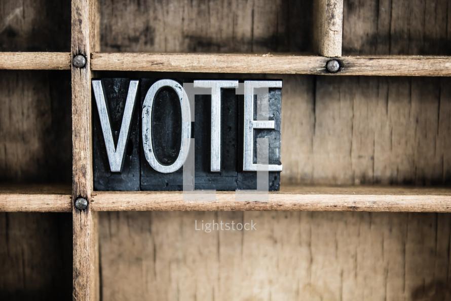 word vote on a shelf