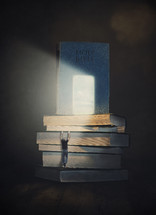 Man climbing up a stack of books to reach the light shining on The Bible.