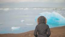 a woman watching icebergs