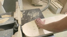 man sanding wood