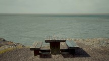 picnic table by a shore