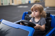 girl child driving a power wheels