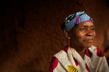 woman with a scarf on her head in Africa