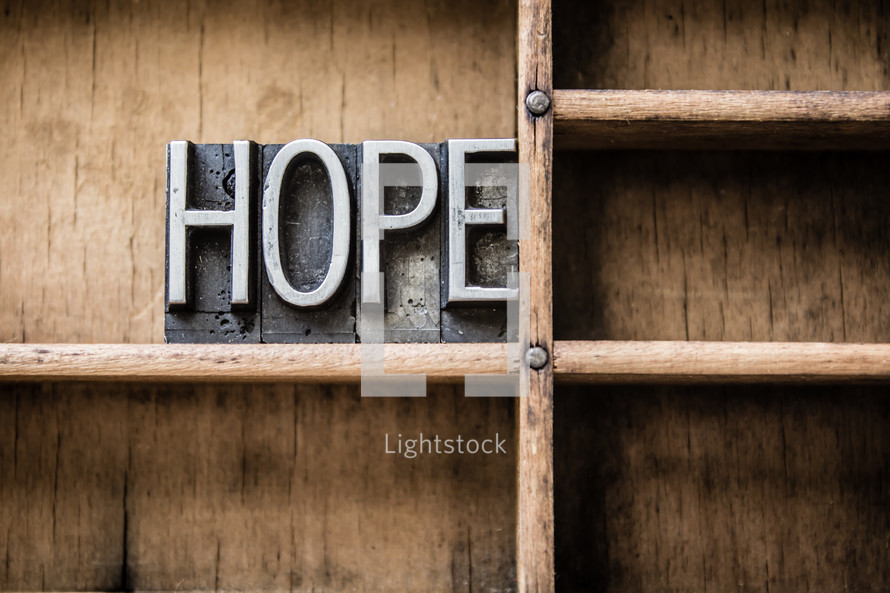 word hope on a bookshelf