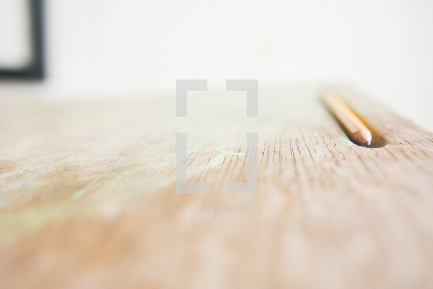 a pencil on a student desk