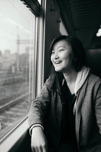 teen girl looking out a train window