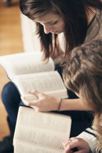 Friends reading the Bible together.